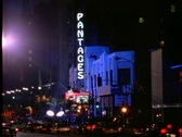 Stock Video Footage of Traffic slowly passes the Pantages movie theater which is hosting a Hollywood