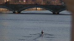 A longshot of a person sculling down the Charles River. - stock footage