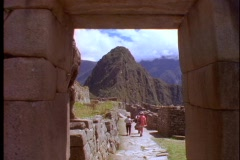 Tourists hike through the ruins of Machu Picchu. Stock Footage