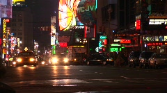 A one-way street in New York after dark with a multitude of lights. Stock Footage