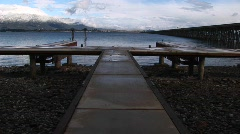 A boat-dock and fishing-pier are deserted in this winter scene Stock Footage