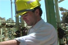 Crab-left of a contractor studying blueprints at construction site. Stock Footage