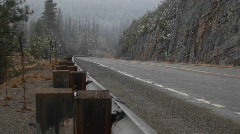 A look at a quiet mountain road during a winter snowstorm Stock Footage