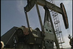 A derrick pumps oil. Stock Footage