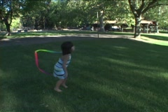 A girl twirls a streamer in her hand. Stock Footage