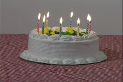 Candles burn down on a white birthday cake. Stock Footage