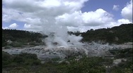 Stock Video Footage of A geyser steams in a thermal region near Rotorua, New Zealand.