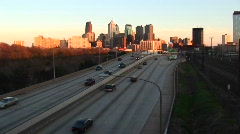 Chicago glows during the golden-hour as traffic enters and departs Stock Footage