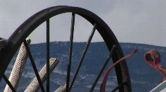 Mountains through the spokes of abandoned wagon wheels Stock Footage