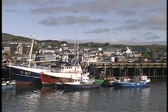 Ships and boats float in an Irish harbor. Stock Footage