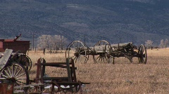 Old wagons and other vintage equipment abandoned on the prairie Stock Footage