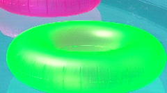 Fluorescent floats in a pool Stock Footage
