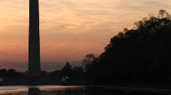 Upward pan of the Washington Monument, silhouetted against a - stock footage