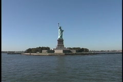 The Statue of Liberty stands in New York's harbor. Stock Footage