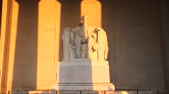 Golden light spills over a statue of President Lincoln. Stock Footage