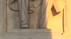 Close up of a statue of President Lincoln bathed in golden light. Stock Footage