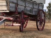Stock Video Footage of A covered wagon with its wagon wheels painted red