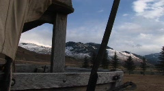 A covered wagon for a view of the mountains beyond Stock Footage