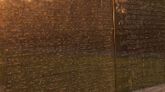 Close up of the Vietnam Veterans Memorial Wall with tributes Stock Footage