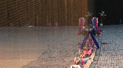 In front of the Vietnam Veterans Memorial Wall, ribbons on tributes Stock Footage