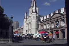 Street vendors sell their wares in the courtyard in front of Jackson Square in Stock Footage
