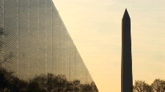 With a golden sky backdrop, the Washington Monument is seen - stock footage