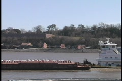 Boats and barges pass slowly by Harpers Ferry, West Virginia. Stock Footage