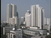 Stock Video Footage of Skyscrapers tower high above the city streets of Bangkok, Thailand.