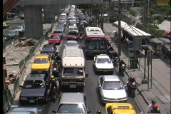 Motorcycles and bicycles work their way through gridlocked traffic on a busy Stock Footage