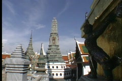 Stone pagodas decorate the rooftops of the buildings of Bangkok, Thailand. Stock Footage