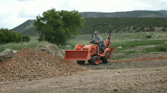 Small yard backhoe tractor moving dirt at new home P HD - stock footage