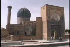 Tourists visit a historic a mosque in Samarkand, Uzbekistan. Stock Footage