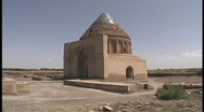 Stock Video Footage of The Seljuk Tomb adorns the desert in Turkmenistan.