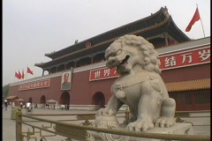 An Imperial lion statue guards the Tiananmen Gate in China. - stock footage