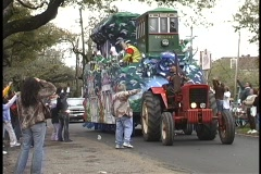 "A Mardi Gras float contains a streetcar called Desire"" and colorfully dressed Stock Footage"