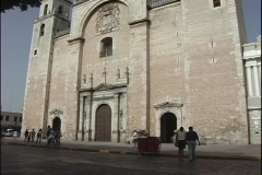 The camera pans up the facade of the Catholic church in Merida, Mexico. Stock Footage