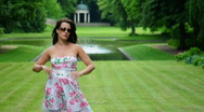 Stock Video Footage of HD720p Young sexy brunnete fashion woman outdoor in the garden looking