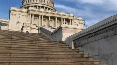 Looking up steps of the landmark U.S. Capitol building in Stock Footage