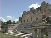 Stock Video Footage of Stairs lead down from an ancient Mayan ruin.
