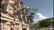 Stock Video Footage of A partial shot of a building shows the carvings done by the ancient Mayans.