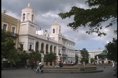 Storm clouds gather and wind blows in San Juan's Plaza de Armas. Stock Footage