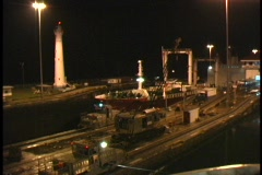 A ship moves through the Panama Canal at night. Stock Footage