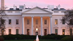 A picturesque look at the White House with outside lights on. Stock Footage