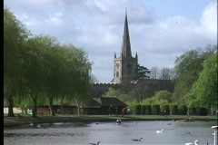 The Holy Trinity Parish Church is seen on the banks of the River Avon, while Stock Footage