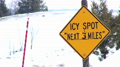 A winter warning sign for drivers and a bright red snow pole Stock Footage