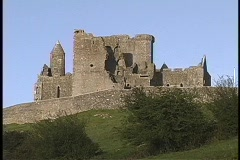 A worms-eye view of the Rock of Cashel ruins on a green hill-top in Ireland. Stock Footage