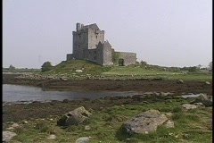 Dunguaire Castle adorns the shoreline in Ireland. Stock Footage