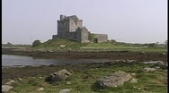 Stock Video Footage of Dunguaire Castle adorns the shoreline in Ireland.
