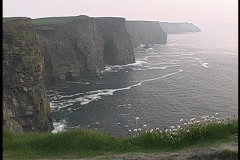 The Cliffs of Moher tower above the ocean in Ireland. Stock Footage