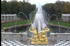The golden statues of St. Petersburg Petrodvorets spray water into a pond. Stock Footage